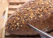 Knife Cutting Whole Grain Bread — Stock Photo
