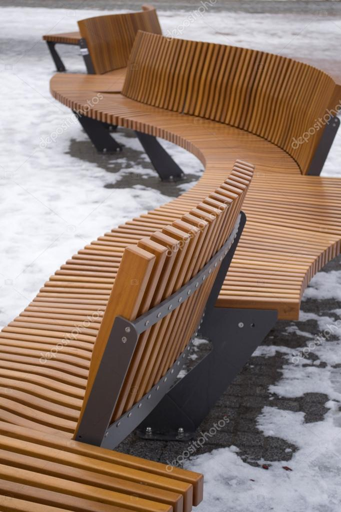 Modern Curved S Shaped Brown Wooden Bench Outdoor Stock
