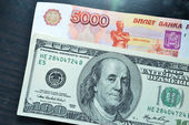 U.S. dollars and Russian rubles. Money — Stock Photo