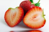 Healthy red strawberry fruit sliced isolated on the white backgr — Stock Photo