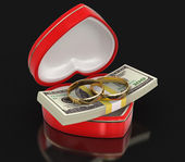 Rings and Dollars in the heart box (clipping path included) — Stock Photo