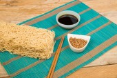 Noodles and condiments — Stock Photo