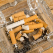 Many  filter cigarette butts — Stock Photo #66208143