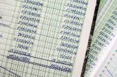 Handwritten accounting on the open pages — Stock Photo