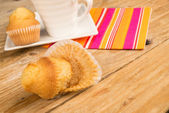 Muffin with crumpled paper — Stock Photo