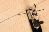 Small fretsaw on a board — Stock Photo
