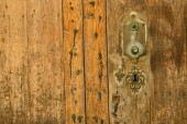 Old door and keyhole as background — Stock Photo