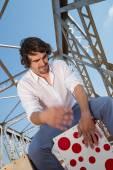 Flamenco percussionist playing on cajon — Stock Photo