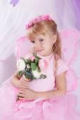 Butterfly girl in wreath holding roses — ストック写真