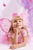 Princess girl in pink crown and butterfly wings making wishes — Foto Stock