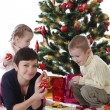 Mother with two children decorating Christmas tree — Stock Photo #59439925