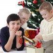 Mother and two children openning presents — Stock Photo #59439947