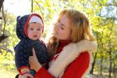 Mother and baby girl talking in autumn park — Stock Photo