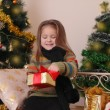Girl opening red gift box — Stock Photo #60135905