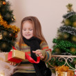 Girl opening red gift box — Stock Photo #60135907