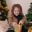 Girl opening red gift box — Stock Photo #60135935