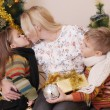 Mother kissing her two children — Stockfoto #60136045