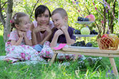 Mother with two children on picnic — Stock Photo