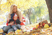 Mother and little girl in park — Stock Photo