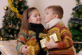 Boy and girl kissing with gifts — Stock Photo