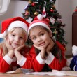 Girls  under Christmas tree — Stock Photo #61838149