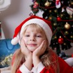 Girl  under Christmas tree — Stock Photo #61838155