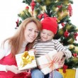 Mother and son opening gifts — Stock Photo #61838227
