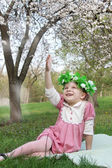Smiling little girl with floral wreath — Stock Photo