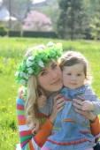Mother hugging baby girl — Stock Photo
