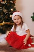 Girl Santa helper under Christmas tree — Stock Photo