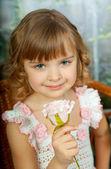 Portrait of beautiful girl in fishnet jersey dress in a wicker c — Stock Photo