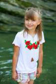 Cheerful girl in Ukrainian embroidery on the background of the C — Stock Photo