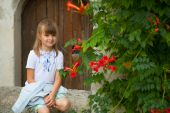 Beautiful girl in the Ukrainian embroidery on a background of be — Stock Photo