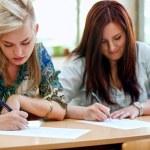 Students taking  exam at the university — Stock Photo #52699903