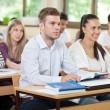 Male student listening a lecture in classroom — Stock Photo #52700809