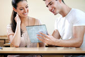 Students with futuristic tablet — Stock Photo