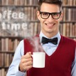 Male student with hot coffee — Stock Photo #53327125