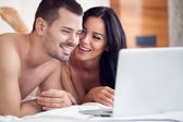 Lovers watching a movie on their laptop — Stock Photo