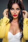 Woman posing in yellow blazer — Stock Photo
