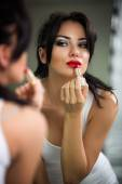 Woman doing make-up — Stock Photo