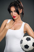 Attractive woman with soccer ball — Stock Photo