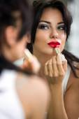 Woman applying red lipstick — Stock Photo