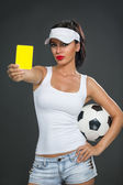 Attractive girl showing  yellow card — Stock Photo