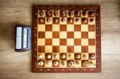 Chessboard with chess and clock — Stock Photo