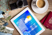 Tablet pc showing weather forecast on screen — Stock Photo