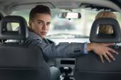 Handsome man driver looking back — Stock Photo