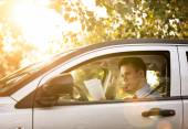 Successful businessman in the car — Stock Photo