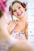 Young pretty girl looking her reflection in mirror  — Stock Photo