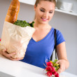 Young woman with groceries in shopping bag — Stock Photo #59270093