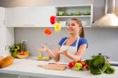 Young woman  juggle with vegetables  — Stock Photo